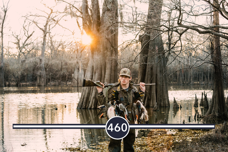 cypress trees and knees at sunset with a louisiana senior guy duck hunting on a lake